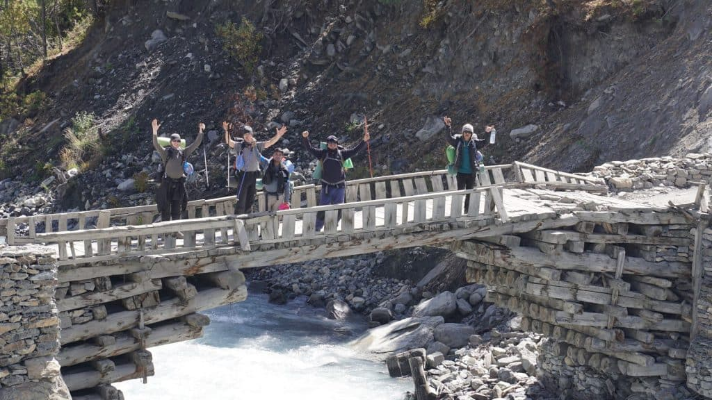 group standing on a bridge in nepal