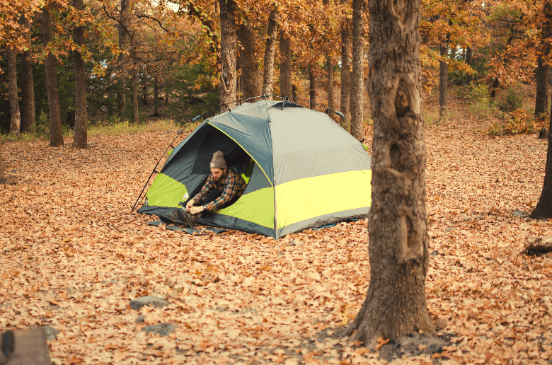 guy in a tent in forest
