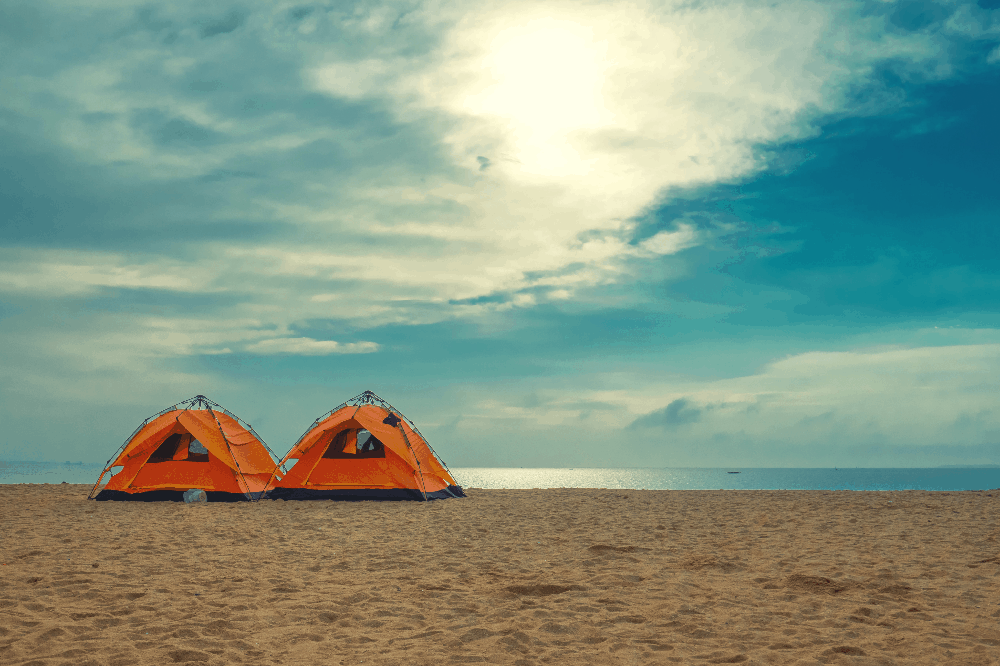 two instant tents set up on the beach