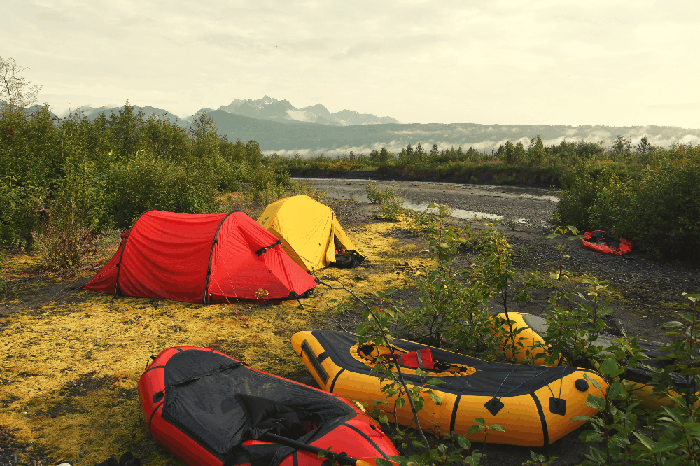 two tents next to rafts
