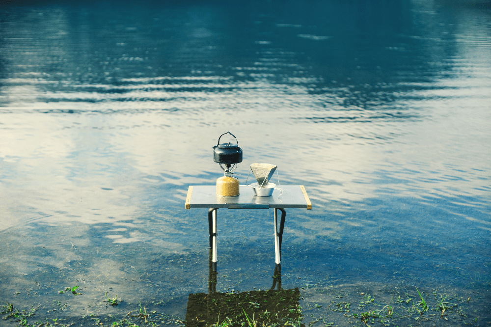 kettle and coffee on a table in the lake