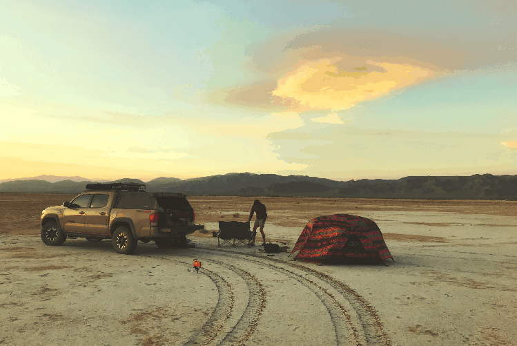 truck and tent in desert