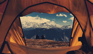 staring out of a tent at mountains