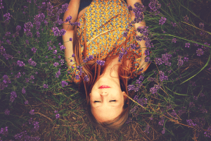 woman sleeping in clover