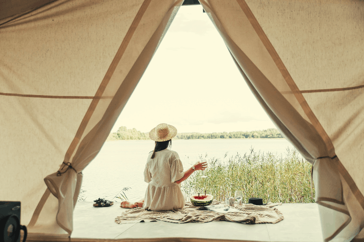 woman outside a yurt