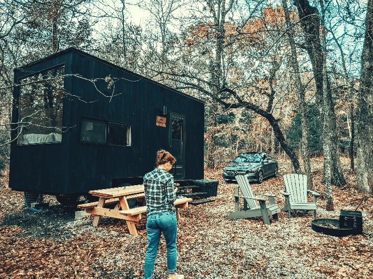 woman outside a cabin