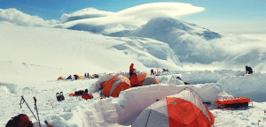 multiple tents in the snow