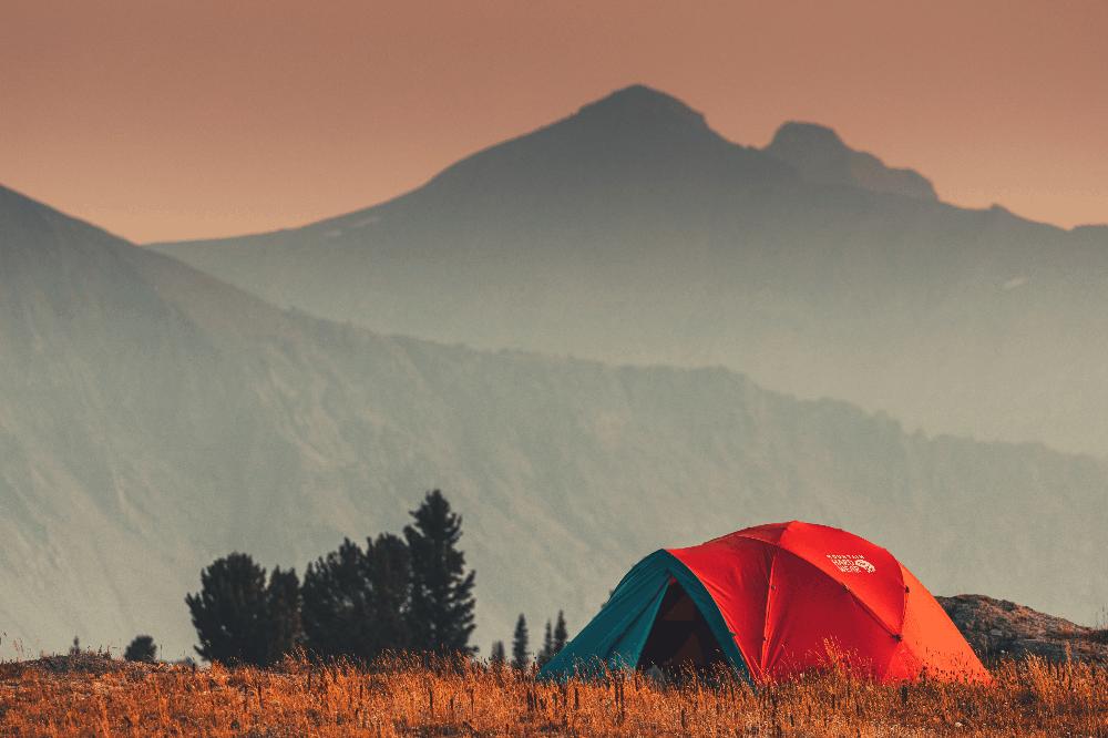 tent on a plain next to mountains