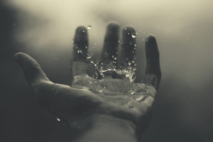 water drops on man's hand