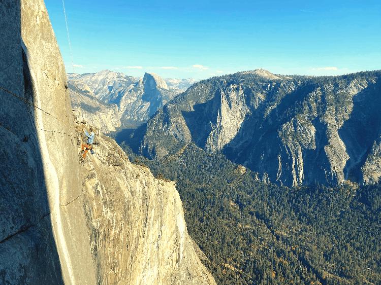 man climbing in yosemite national park