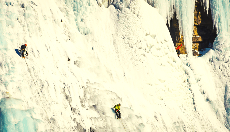 people ice climbing