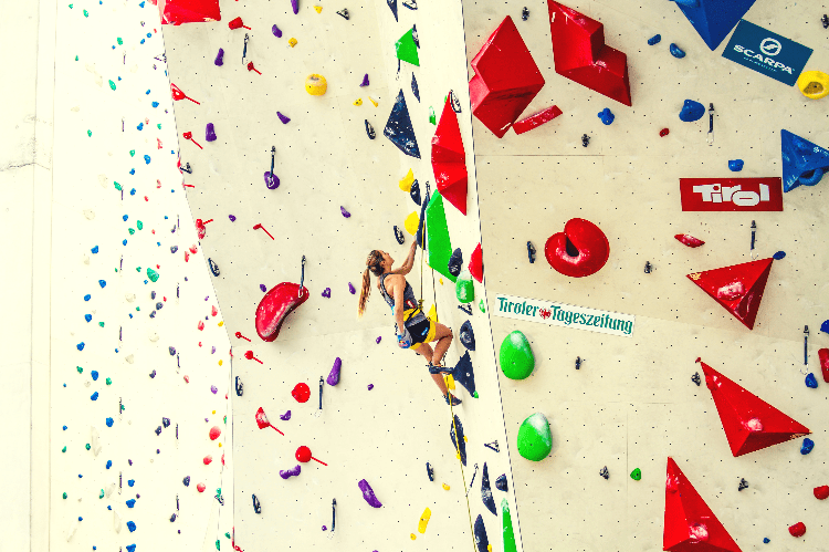 girl sport climbing in a gym