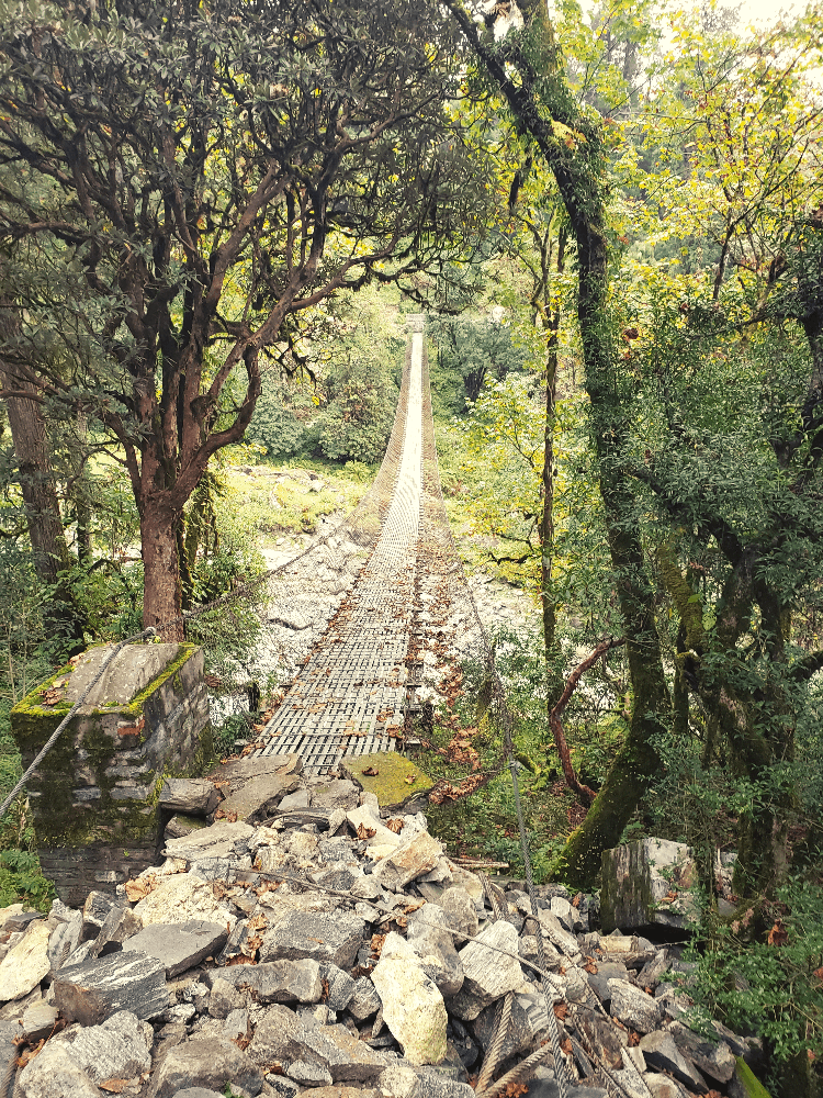 broken swinging bridge in Nepal