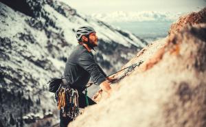 man rock climbing in the mountains