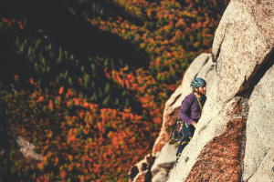man trad climbing in fall