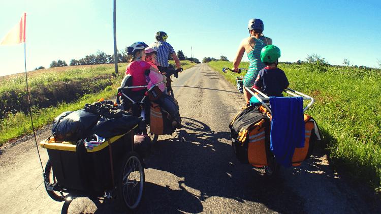 kids biking with parents