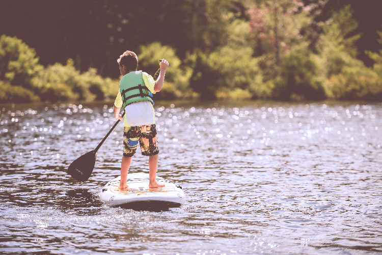 kid on a paddleboard