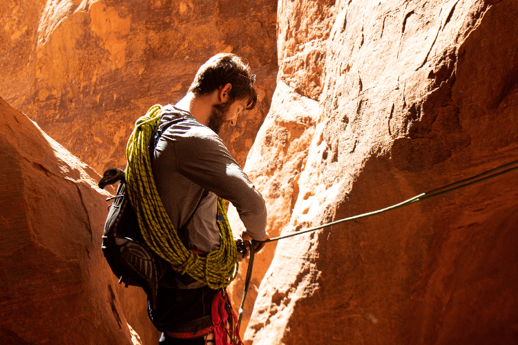 man winding up his climbing rope