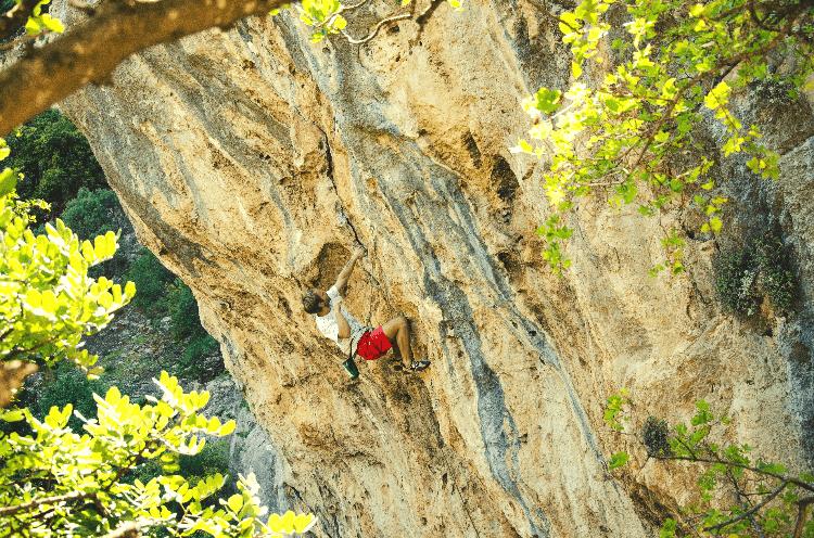 man sport climbing
