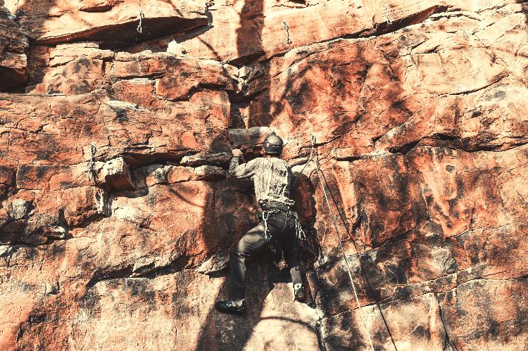 man rock climbing outdoors