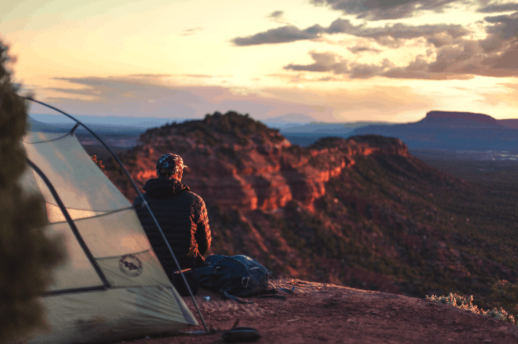 man camping in the sunset