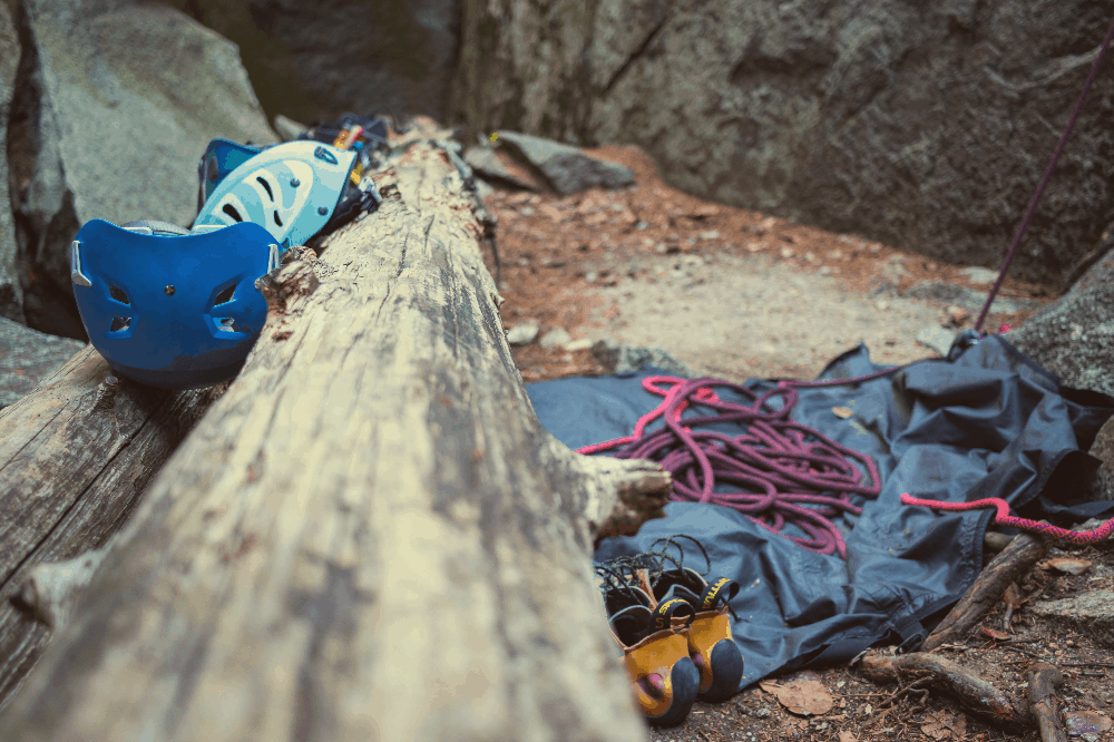 climbing gear spread out on the ground