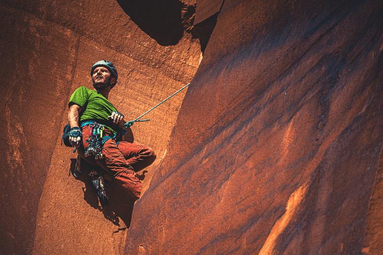 man rock climbing on sandstone