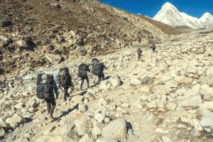 trekkers hiking through the himalayas