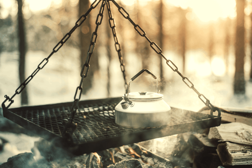 kettle above a campfire