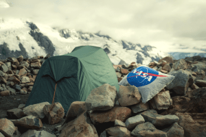 tent with a nasa pillow on rocks