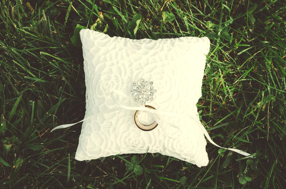 white pillow on the grass