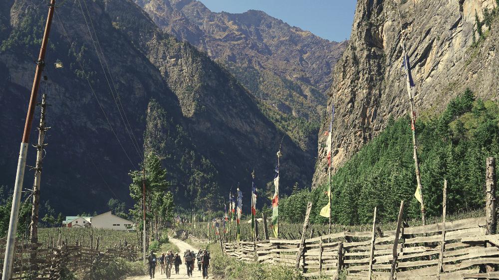 people walking through the himalaya mountains