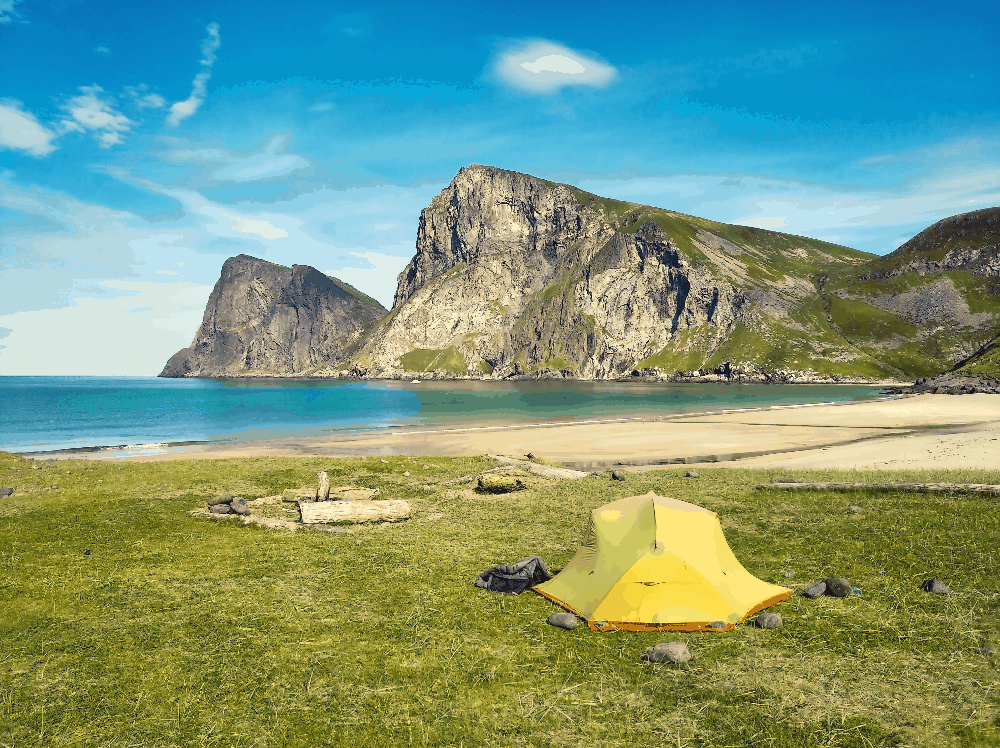 tent on flat ground by ocean