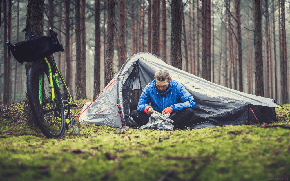 man sitting in his tent