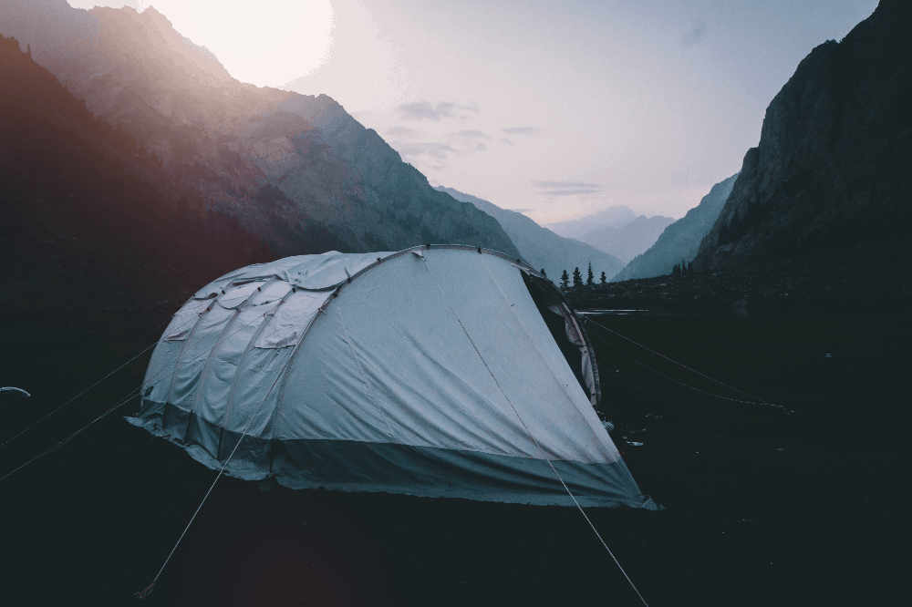 tent staked down at dawn