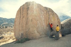 large boulder with a person climbing on it