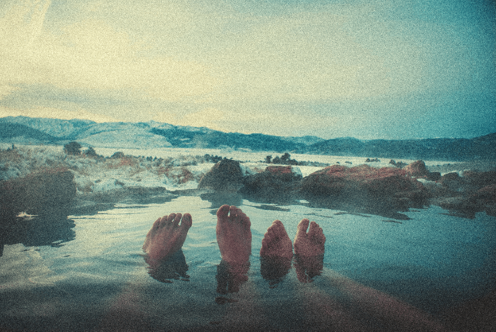 people soaking in a hot spring