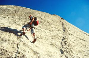 man rock climbing yosemite valley