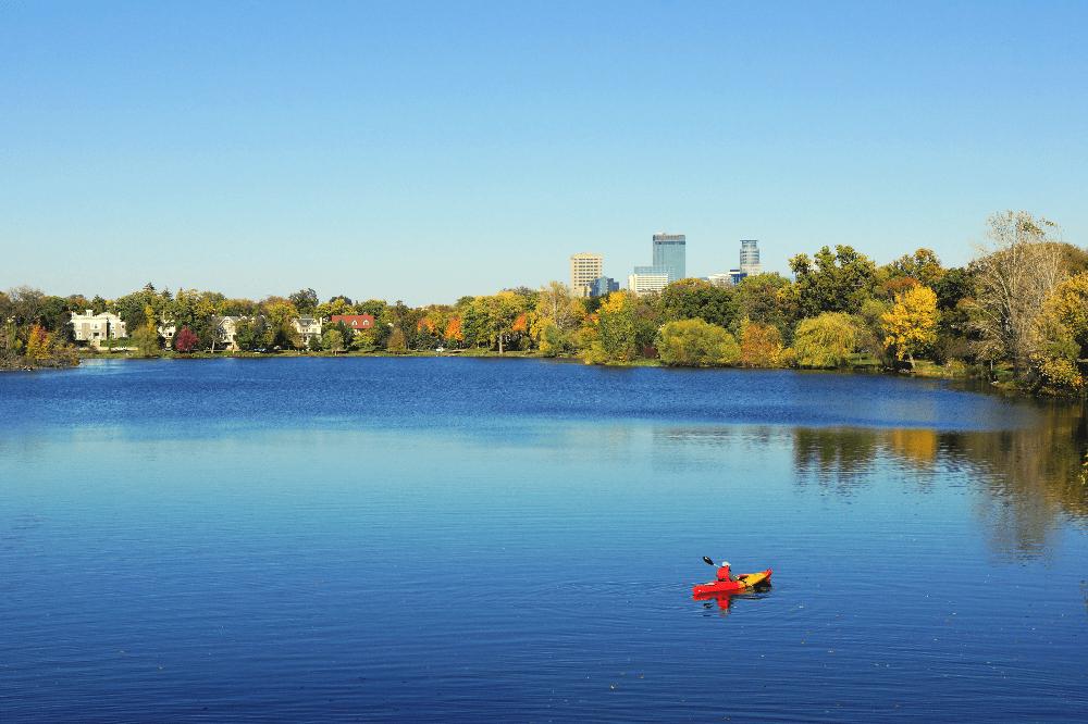 person kayaking on lake in minneapolis