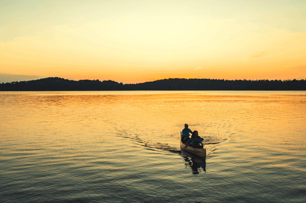 canoe on the lake at sunset