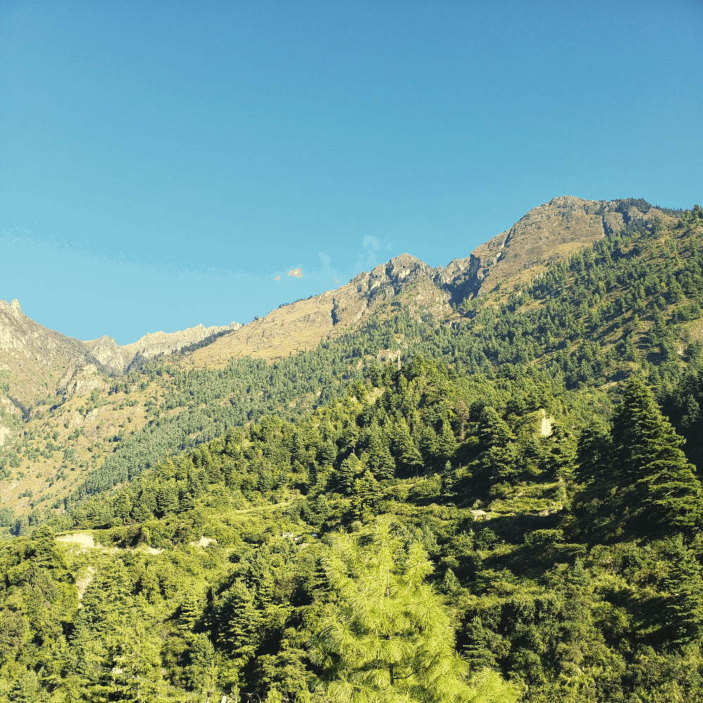 nepal mountains under clear blue sky