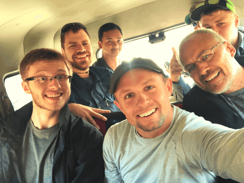 group of people in a jeep