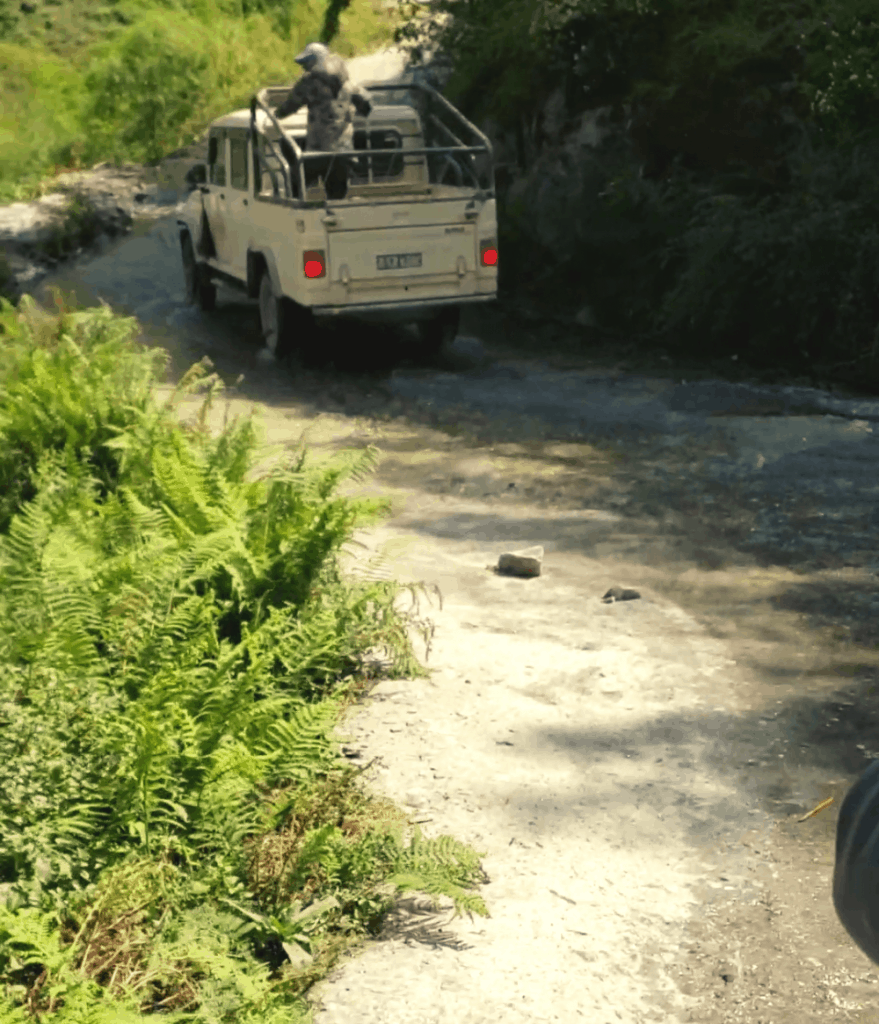 jeep driving down a dirt road in nepal