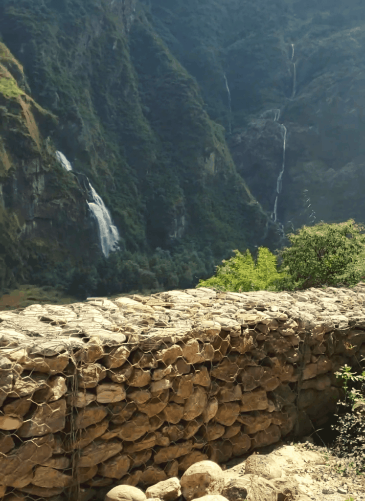 waterfall on a road in nepal