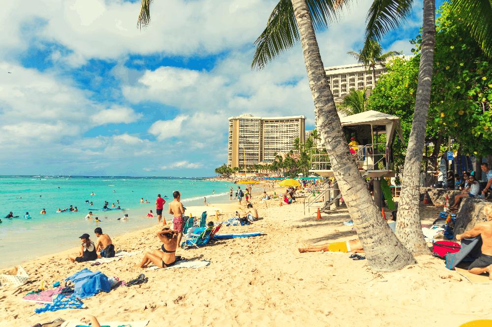 people laying on a beach in hawaii
