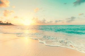 sunset over a beach in hawaii