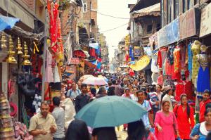crowd of people walking through kathmandu