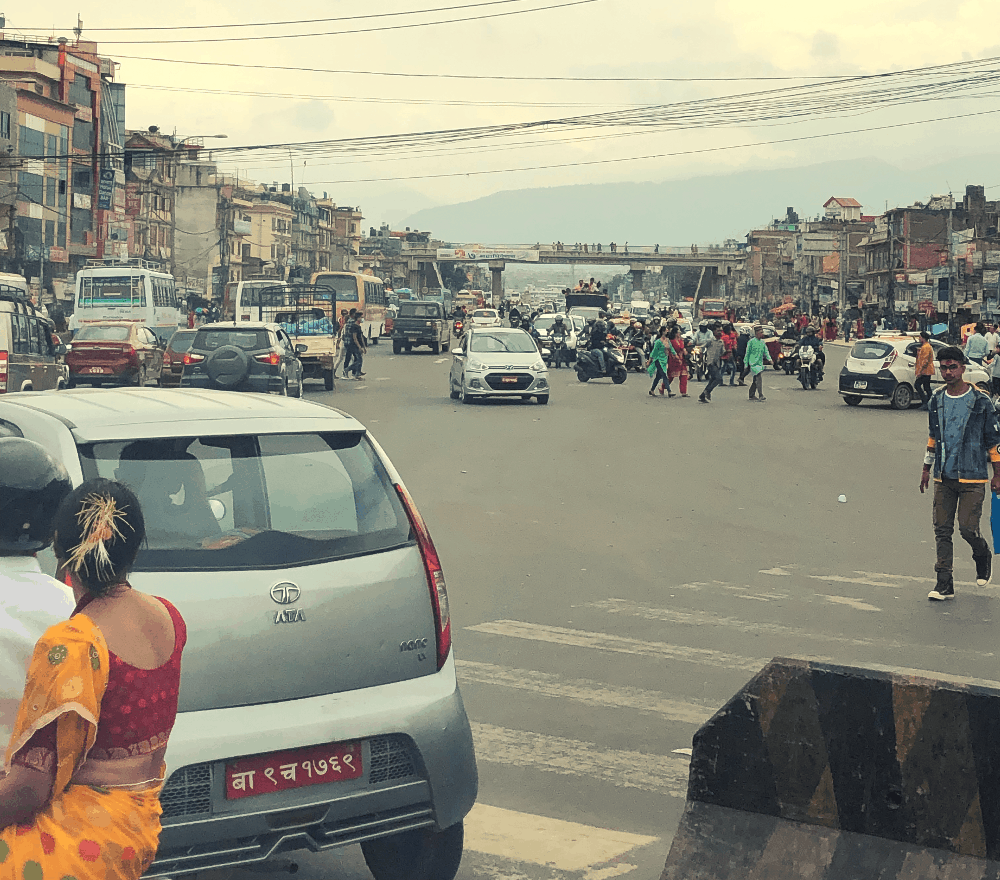 people walking through the streets of kathmandu