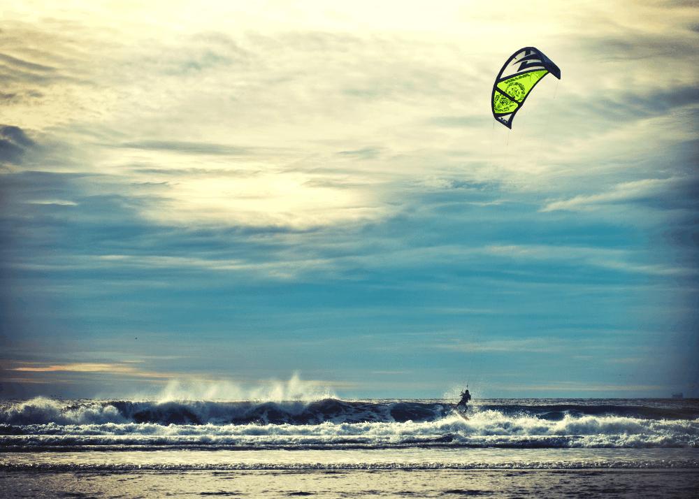 man windsurfing on a beach in california