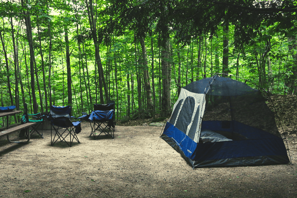 campsite with a blue tent and two chairs